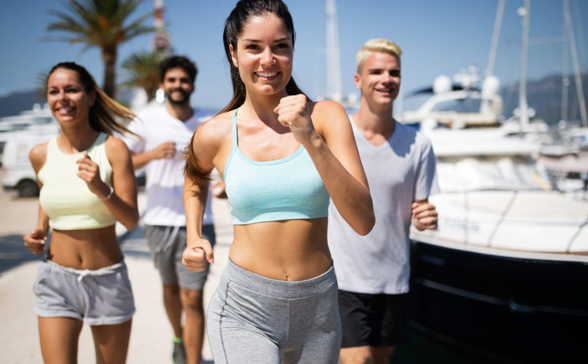 Healthy group of friends running and enjoying friend time together