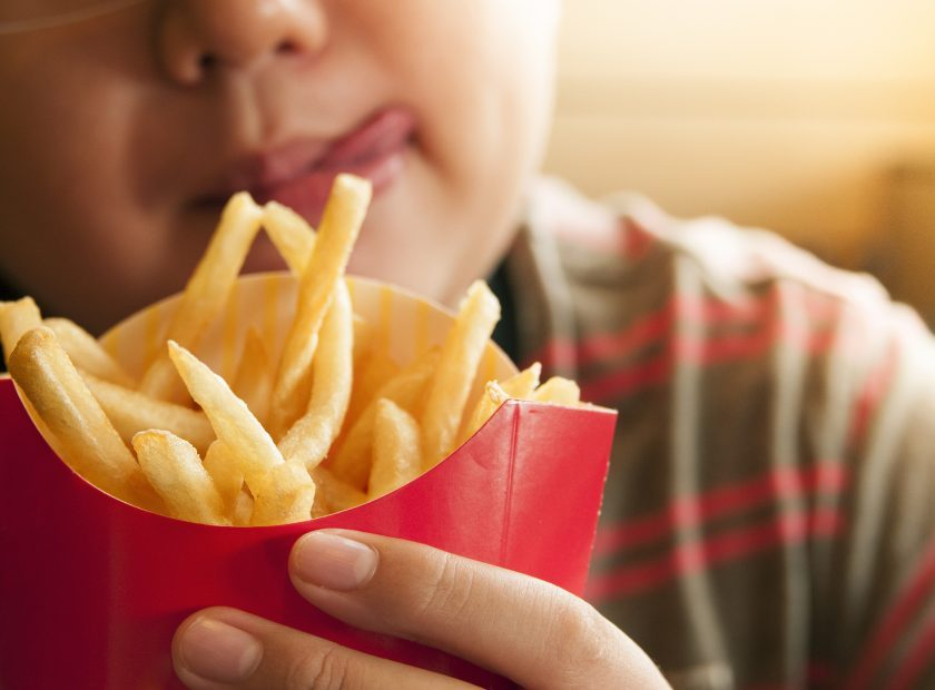 Kid Holding French Fries Packet